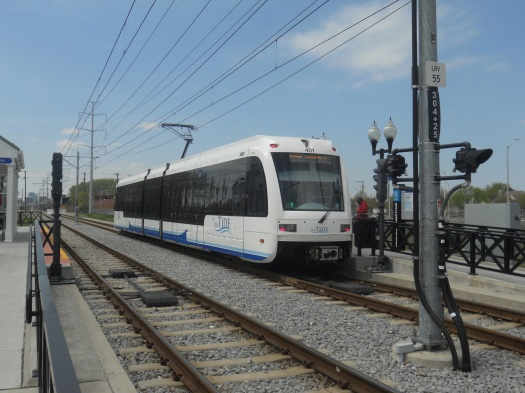 A Siemens S70 LRV train departs the Ballentine-Broad Creek LRT station just outside of downtown Norfolk. Photo taken by HARTride 2012 on April 13, 2013.