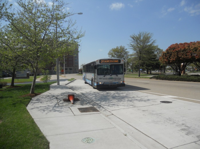 A Gillig Phanton bus (# 1807, running on Route 44) pulls into the EVMC station along the southwest edge of Norfolk. Photo taken by HARTride 2012 on April 13, 2013.