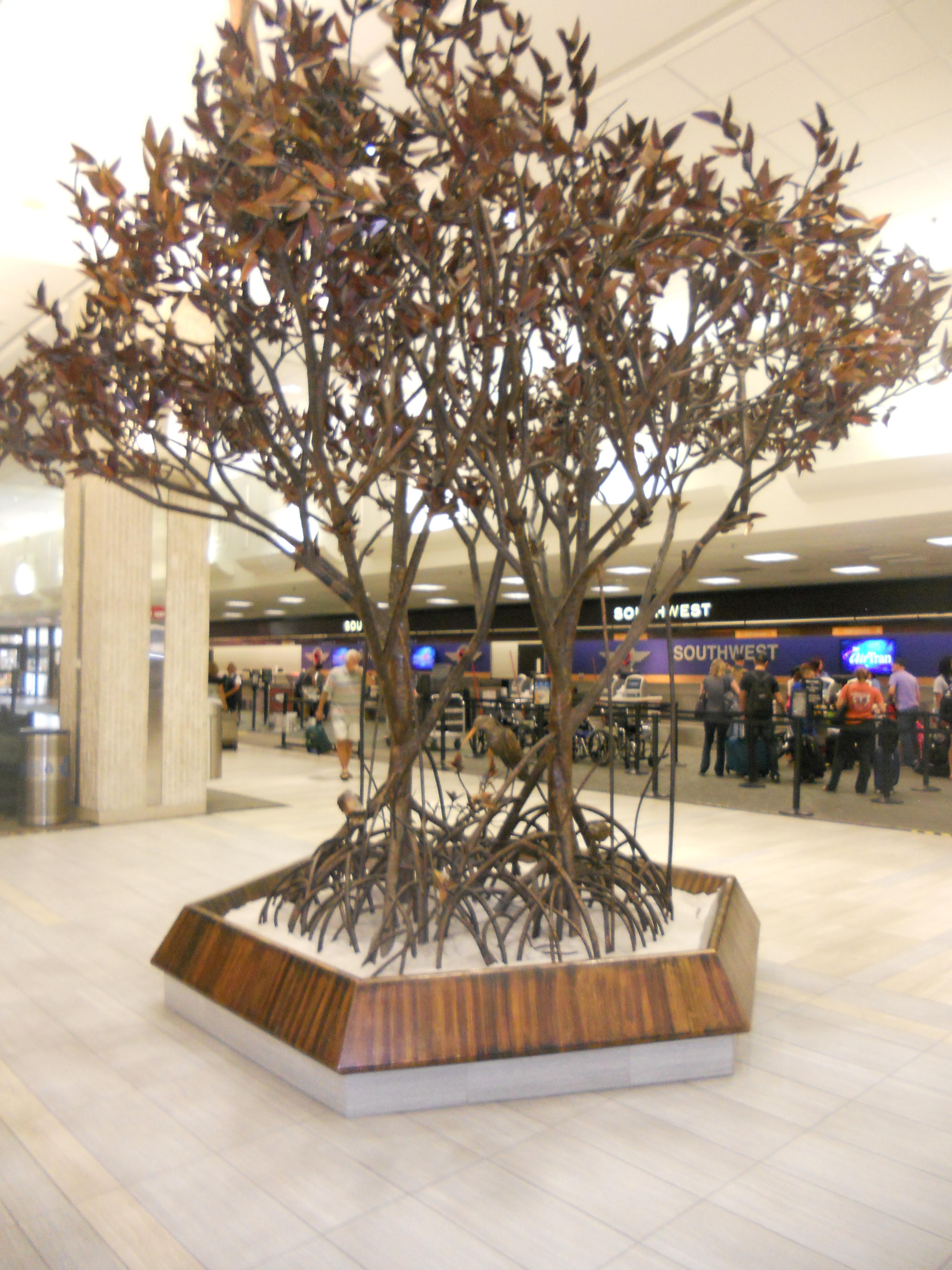 """""""The Meeting Place"""" by Roy Butler sits on Level 2 of Tampa International Airport's main terminal. This art piece has been a fixture in the main terminal since the 1970s. Photo Credit: HARTride 2012."""