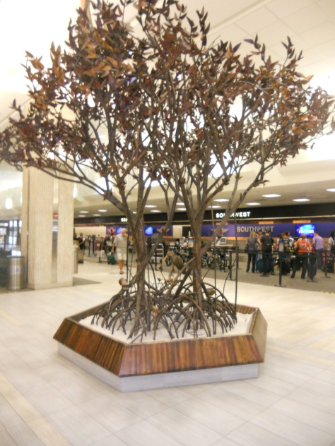 """The Meeting Place"" by Roy Butler sits on Level 2 of Tampa International Airport's main terminal. This art piece has been a fixture in the main terminal since the 1970s. Photo Credit: HARTride 2012."