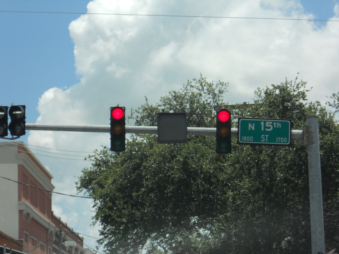 The gray box between these traffic signals, shows a NO TURN arrow when a streetcar or light rail train approaches the area. Photo taken by HARTride 2012