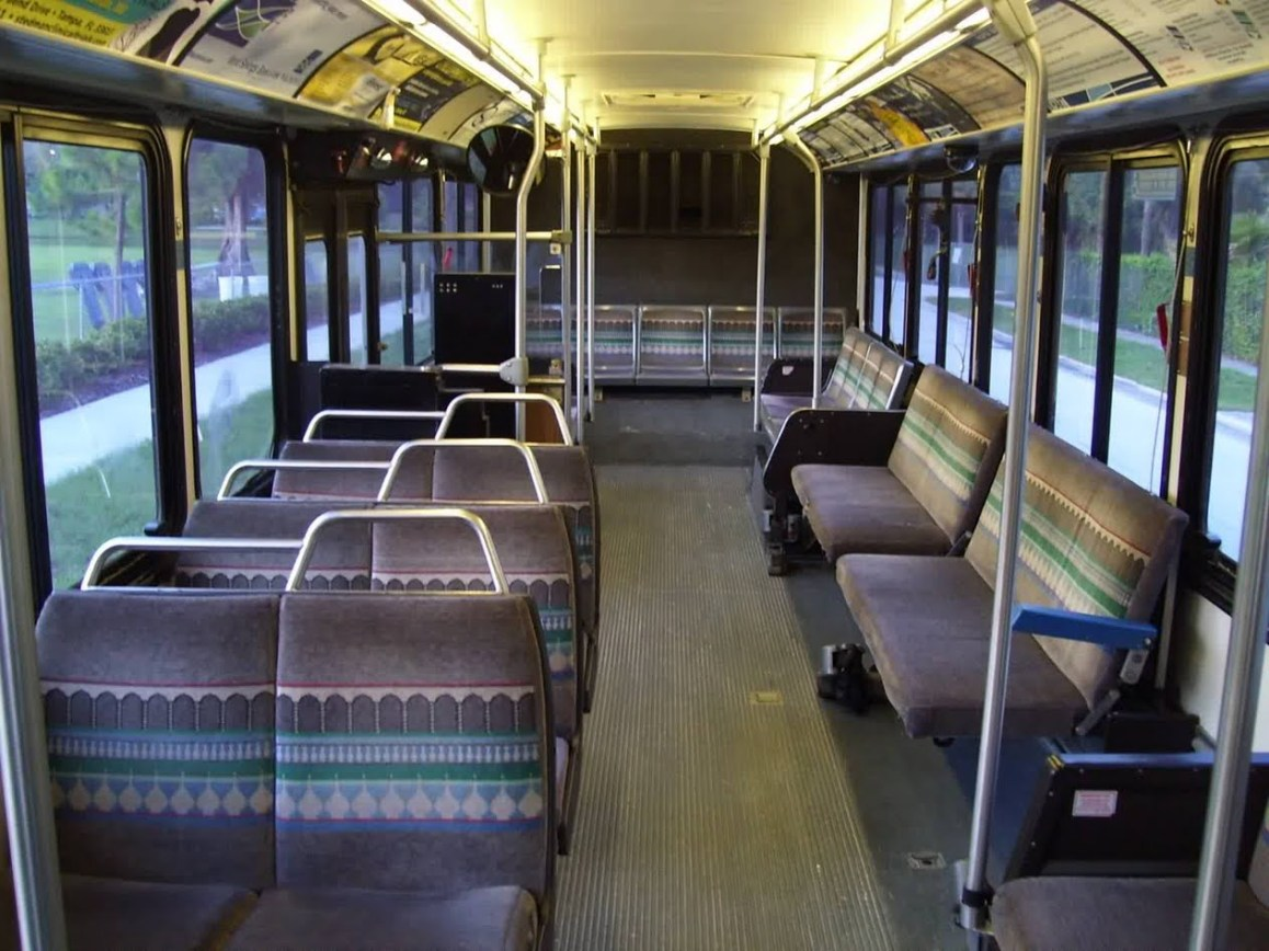 Here's the interior of the Phantom. They had plush interiors by old standards, and the only real drawback was the wheelchair lift being in the back door. Newer Phantoms, like the ones at Sarasota County Area Transit and the Pittsburg Port Authority, were built with them in the front steps. Still, however, is not as nice as the low floor design. Photo Credit: Shawn B.