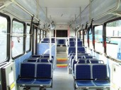 """An interior shot of #2901. All of the 2009, 2010, 2012 (except MetroRapid), and 2013 buses follow this blue theme. The MetroRapid buses follow a green and grey theme with """"jungle-style"""" seating cushions instead of the blue thatches. The side wall panels are of a sky blue laminate, instead of a purple laminate with the 2006-series buses. You'll also notice that the seating configuration is very similar to the 2003-series and onward buses, being that they all face forward. However, there is the """"stadium seating"""" arrangement that is identical to the 1999 and 2001-series buses. Nice one-piece flooring too. Photo Credit: Shawn B."""
