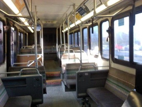 "Inside #906. Like the Gillig Phantoms, these buses had plush seating towards the front of the bus, as well as sideways-facing seats. Notice the ""stadium-style"" row on the right. This configuration was adopted by the 2001-series buses, as well as the 2009 and onward series buses. Photo taken by HARTride 2012. September, 2010."