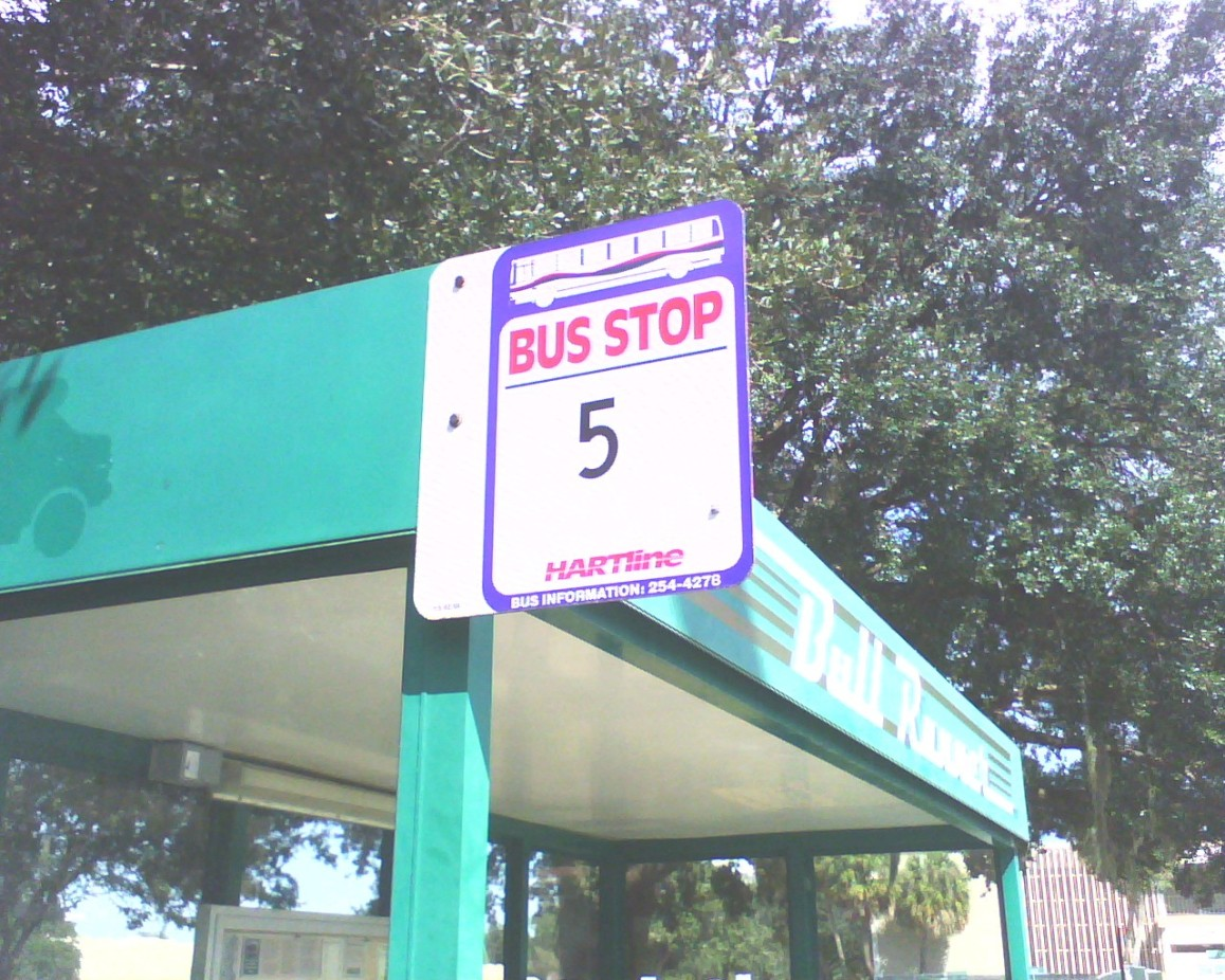 """The Flxible Metro is shown at the top of the old """"HARTline"""" bus stop shield. All of the old shields have since been replaced with newer blue """"HART"""" ones. Photo taken by HARTride 2012. March, 2010."""