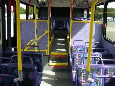 "The purple interior of a 2005-series bus. Another reason why I called these buses the ""Purple People Eaters""! Also notice the ""Aquamarine"" themed seating cushions."