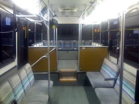 The interior of a 2000-series bus. Notice how all the seats face sideways (except the back)? You could throw a party there because there is so much room (lol). Photo Credit: Shawn B.