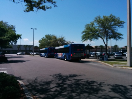 "Two 2013-series buses on ""lineup"" at Britton Plaza. This was taken during the 2014 AirFest at MacDill AFB, where HART ran the Route 4 ""Shuttle"". Photo Credit: HARTride 2012. March, 2014."