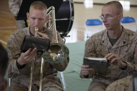 Two Marines (twin brothers) take a few moments to sharpen their music skills. Photo Credit: US Marines/Lance Cpl. Elizabeth A. Case.
