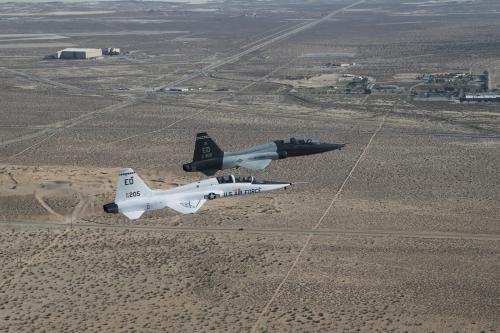 Two US Air Force jets fly side-by-side over the desert. One is a T-38 A-model and the other a T-38 C-model. Not sure which one is which though. Photo Credit: US Air Force/Bobbi Zapka.
