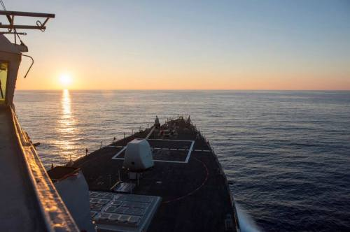 Looking into the sunrise (or sunset, depending how you look at it) from the USS Ramage (DDG 61). The US Navy guided missile destroyer is on a Mediterranean deployment until the spring of 2014. This particular photo made the weekly cover photo rounds on the US Navy's official Facebook page during the week of November 4, 2013. Photo credit: US Navy.