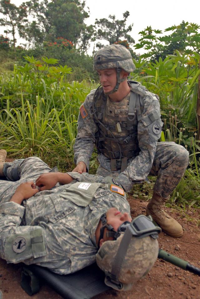 Two soldiers participate in a casualty exercise. Photo Credit: US Army.