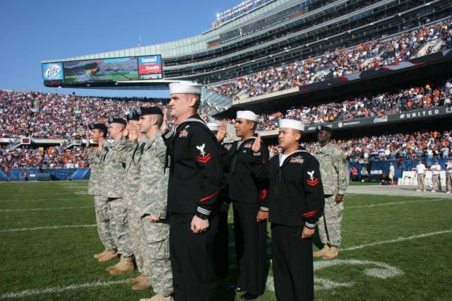 Military members can always be seen at major sporting events, especially during the playing of our National Anthem. Photo Credit: US Army.