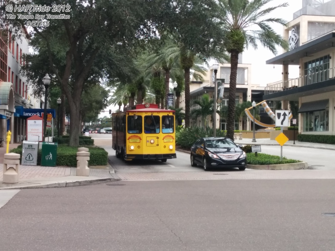 "A ""Looper"" trolleybus at 2nd Ave N and 2nd St N, across from the Sundial Shoppes at St. Pete."
