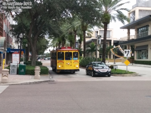 """A """"Looper"""" trolleybus at 2nd Ave N and 2nd St N, across from the Sundial Shoppes at St. Pete."""