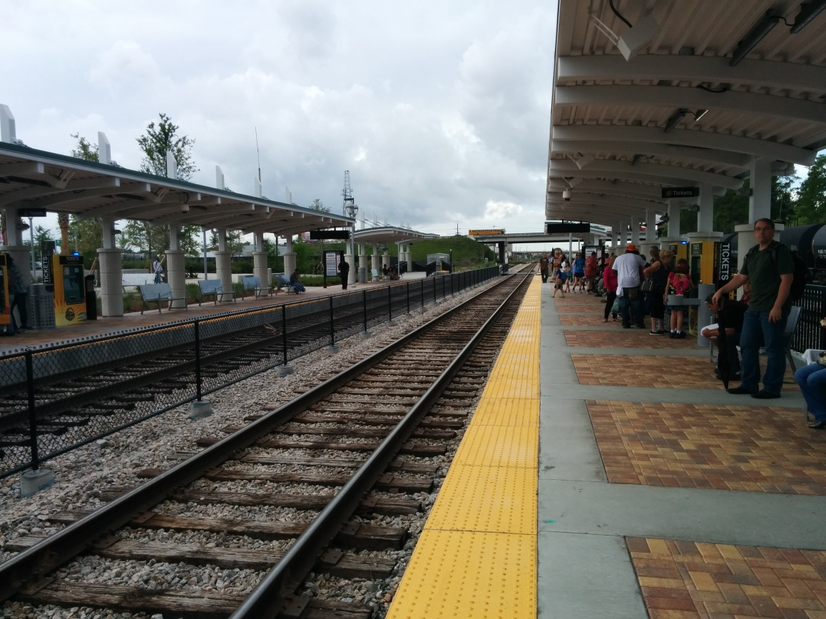 Crowds build up on the platform as they await the arrival of the first afternoon train to DeBary. Photo Credit: HARTride 2012. May, 2014.