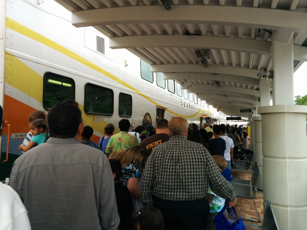 The crowds board the train. Photo Credit: HARTride 2012. May, 2014.