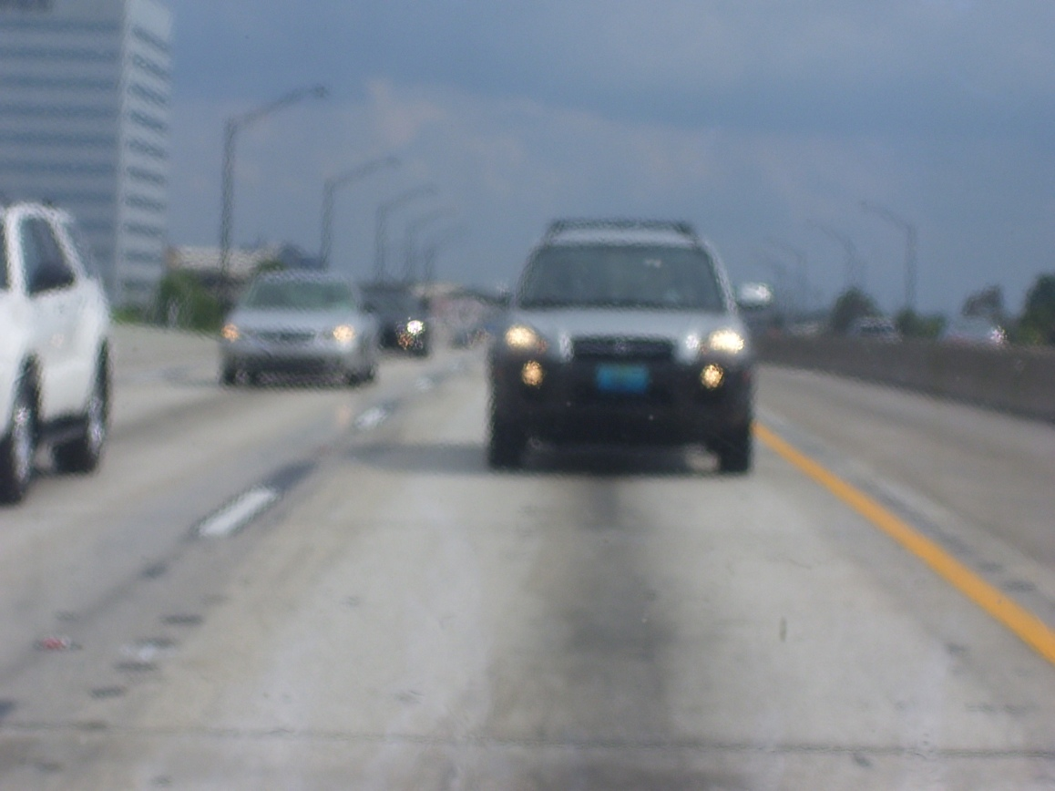 In the back passenger seat looking back as my family traveled down I-4 near downtown Orlando in 2008. Photo Credit: HARTride 2012. August, 2008.