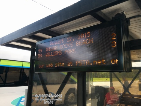 Looking at a LED board that displays arrival times for each route serving Gateway Mall.