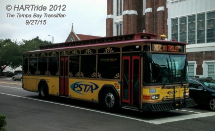 #821 leaving Williams Park. Notice how unlike most o the other yellow trolleybuses, #821 has the regular PSTA logo on both sides of the bus.